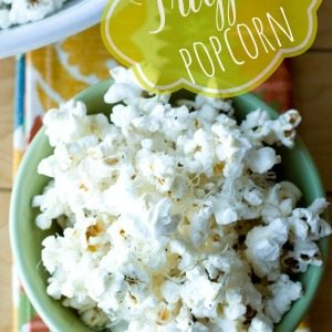 A bowl of truffle popcorn in a bowl with text overlay for Pinterest