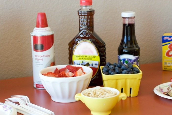 All of the toppings for a waffle bar.