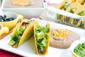 This Oven Tacos Recipe is so easy to make plus it makes enough to feed a crowd! They're economical and you can customize them to fit your family's taste buds!