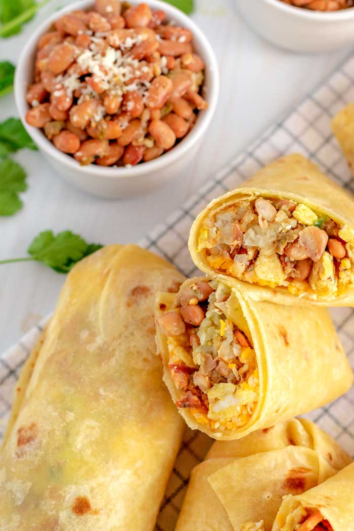Breakfast burritos with green chile pinto beans.