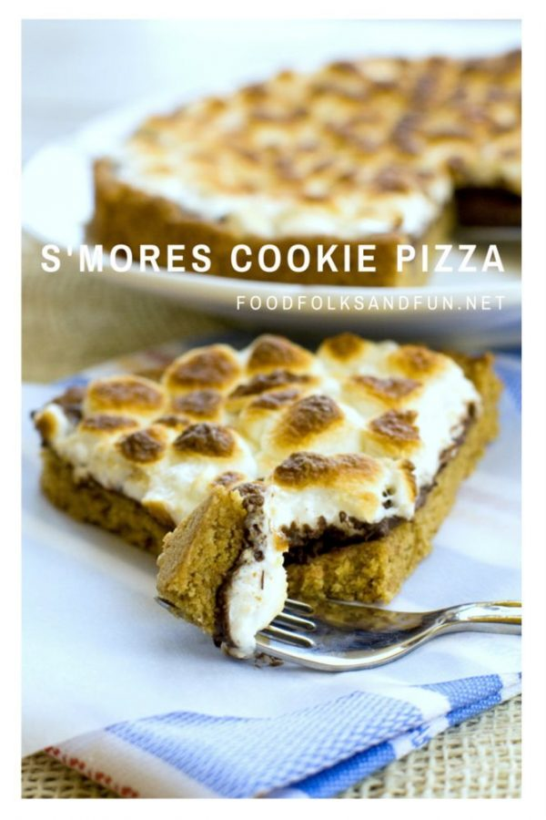 Slice of cookie pizza being eaten with a fork.