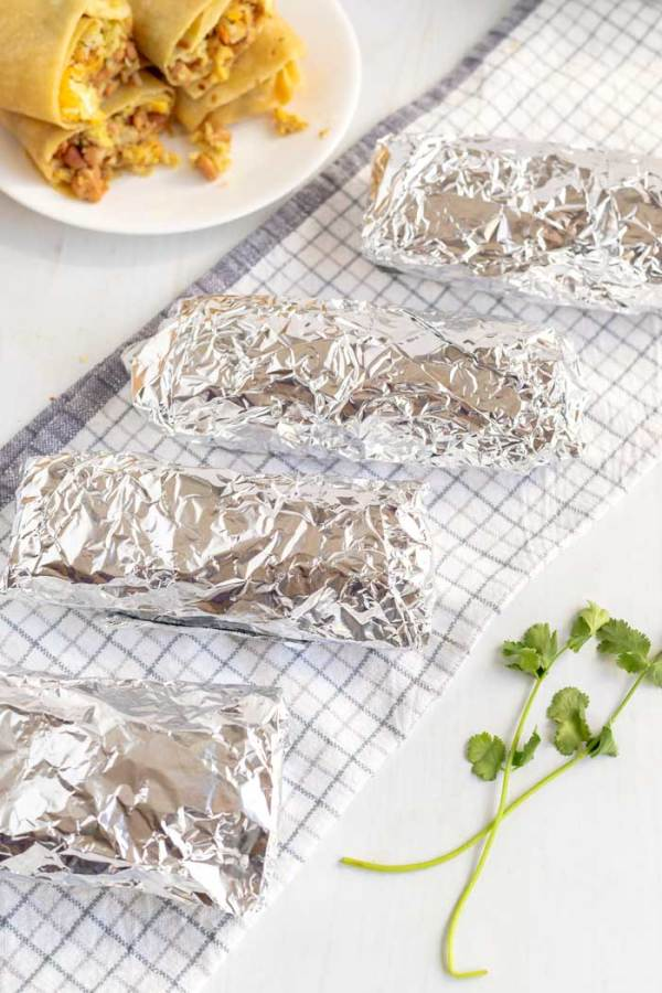 Breakfast Burritos wrapped in foil and ready to be frozen.