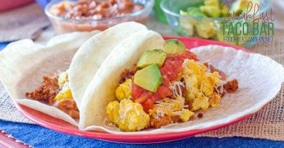 2 breakfast tacos on a plate.
