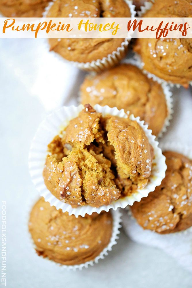 Pumpkin Honey Muffins stacked on top of each other with one muffin split in half.