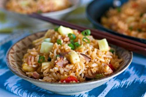 Put those holiday ham leftovers to good use by making this Hawaiian Fried Rice recipe. It's quick, easy and SO delicious!