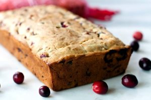 This is a great Cranberry Bread Recipe that's packed with orange flavor and pecans. It makes 2 loaves so it's great for gifting during the holidays! Give both or keep one for your family!
