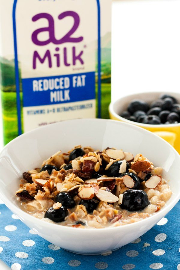 Overnight Blueberry-Almond Muesli in a white bowl with a blue napkin.