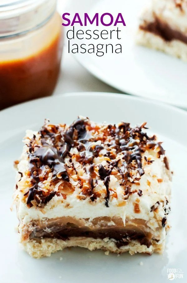 Samoa Dessert Lasagna is a layered dessert that's inspired by the beloved Samoa cookie! It starts with a coconut shortbread, then layers of creamy chocolate cream cheese, caramel pudding, whipped cream, are added. Finally it's topped off with toasted coconut, hot fudge and caramel!