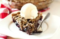 This Cherry Crumble Pie features summer's juiciest cherries covered in a crumble topping of oats, brown sugar and cinnamon.
