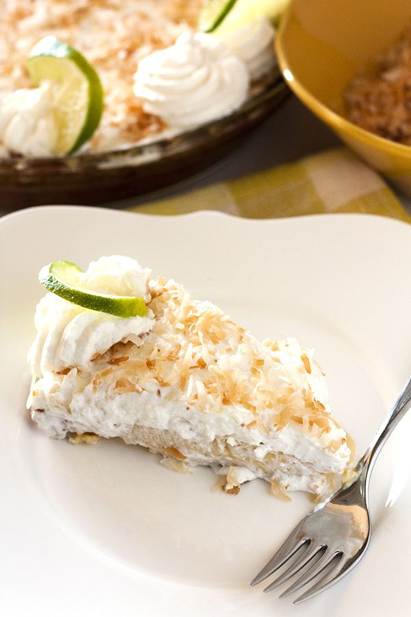 Key Lime Pie is simply THE pie of summer! This recipe has an amazing coconut graham cracker crust, a creamy lime interior, and a perfectly sweet whipped cream topping.