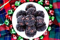 These Dark Chocolate Cherry Cookies with Almonds are chewy, fudgy, and oh so good! They're festive and great for gifting-either baked or in cookie dough form!