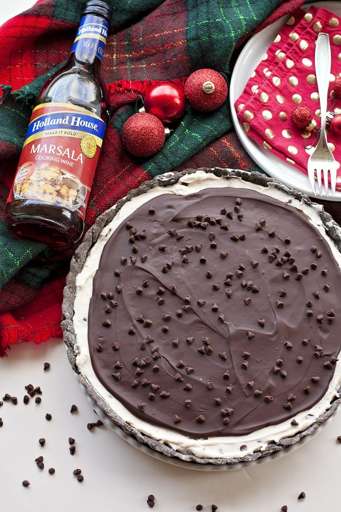 A chocolate cannoli tart with a bottle of Marsala Cooking Wine on the side