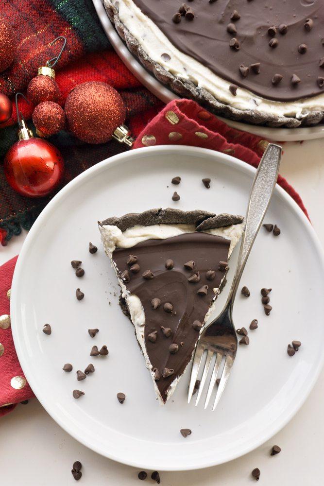 A slice of a Chocolate Cannoli Tart on a white plate.