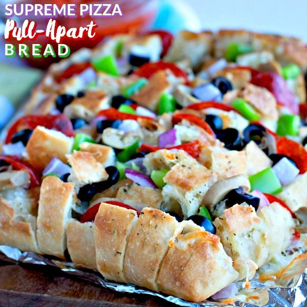 Supreme Pizza Pull Apart Bread is loaded with all of your favorite toppings. It's an easy, delicious, and cheesy appetizer for game day, parties, or heck--even dinner!