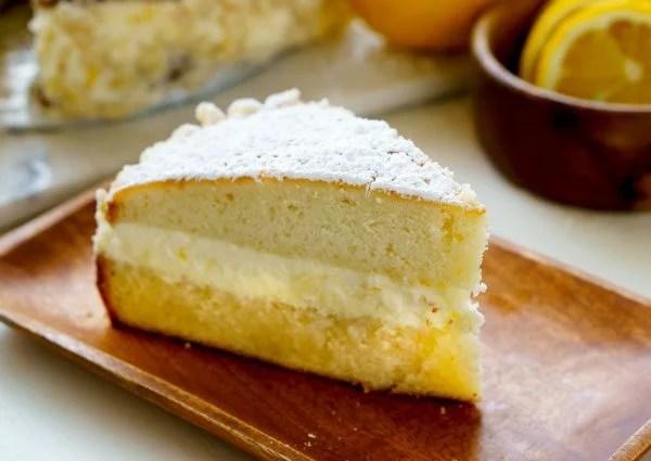 A close-up of a piece of Olive Garden Lemon Cream Cake.