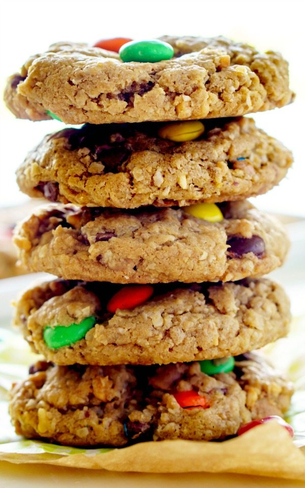 A stack of Monster cookies on a plate