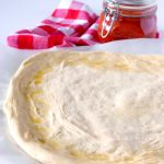 Making the ultimate homemade pizza dough.