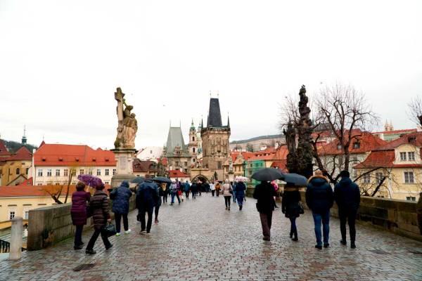 Walking across the St. Charles Bridge in Prague, Czechia.