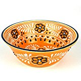 A decorative large serving bowl