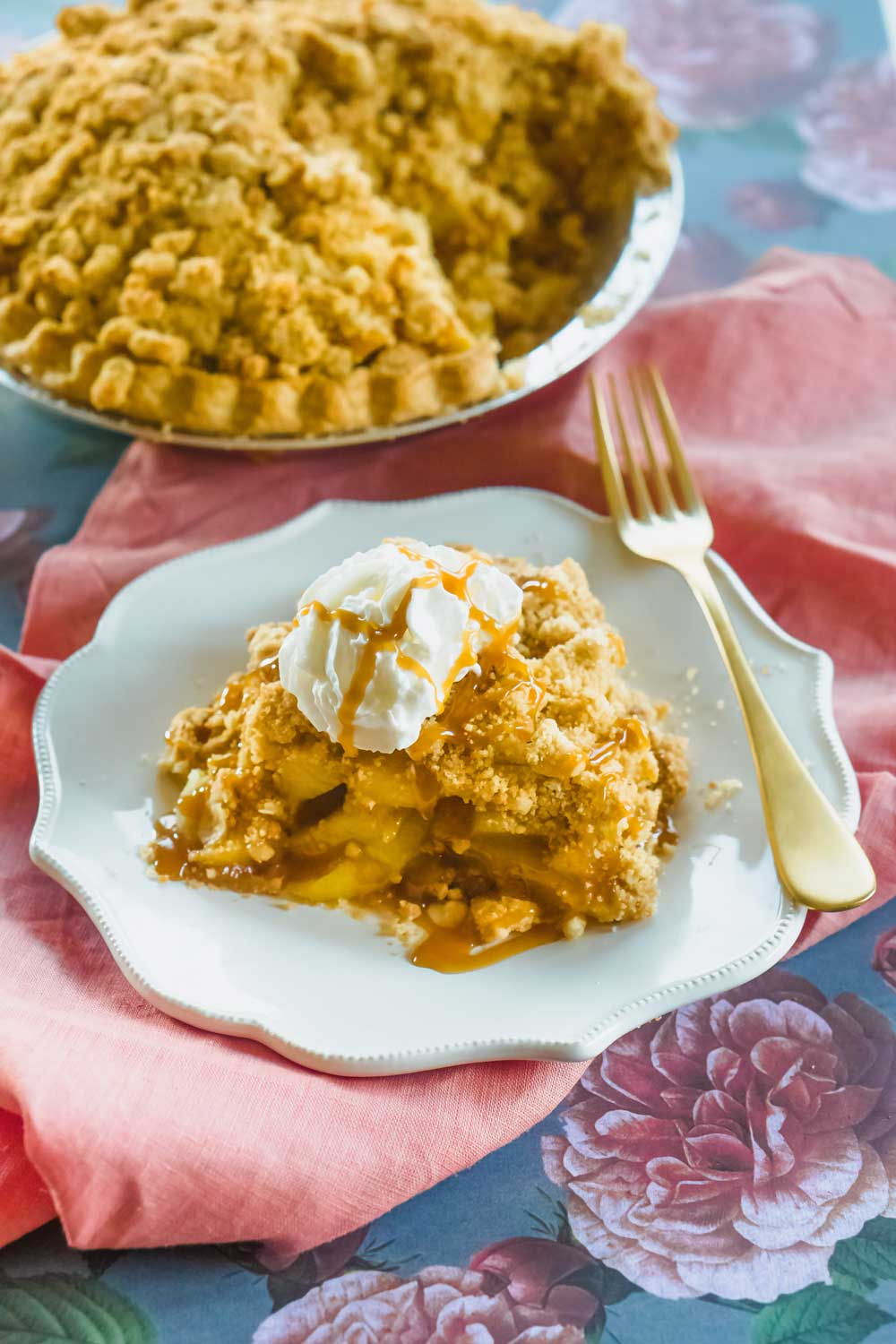 Quick Dutch Apple Pie on a plate with the entire pie in the background
