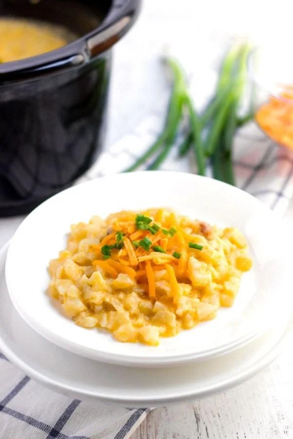 A plate of Crockpot Cheesy Potatoes