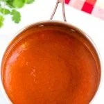 Finished enchilada sauce in a saucepan.