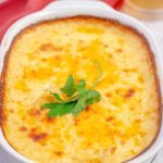 A close up of Cheesy Au Gratin Potatoes in a casserole dish