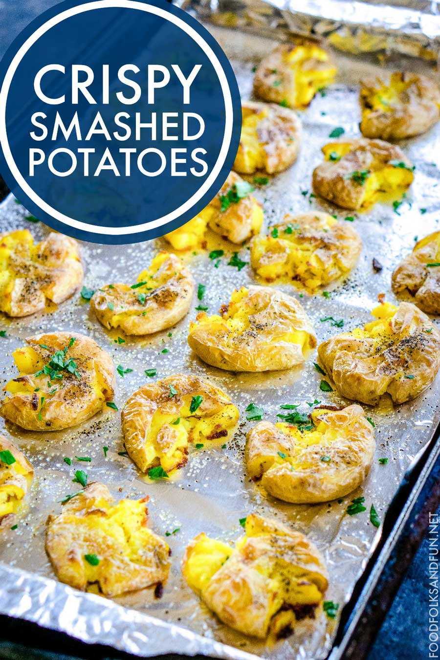 Smashed Potatoes on a baking sheet with text overlay for Pinterest