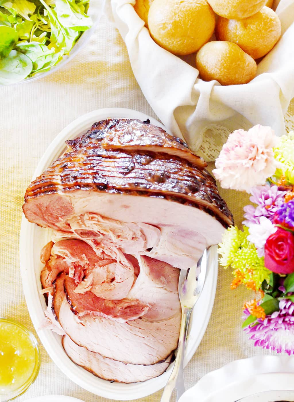 A sliced ham on a plate