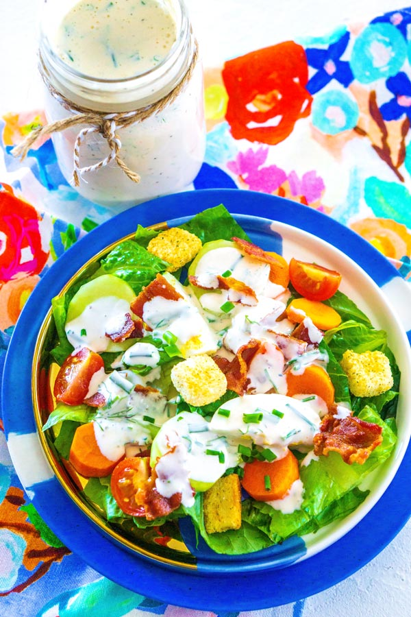 An overhead picture of a salad dressed with buttermilk ranch.