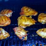 Flip the chicken over and grill until golden.