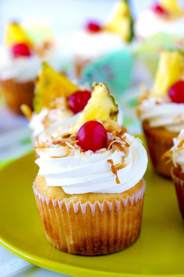 Coconut-pineapple cupcakes with coconut cream cheese frosting.