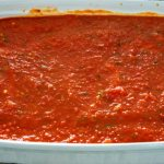 Cover the manicotti with the remaining sauce.
