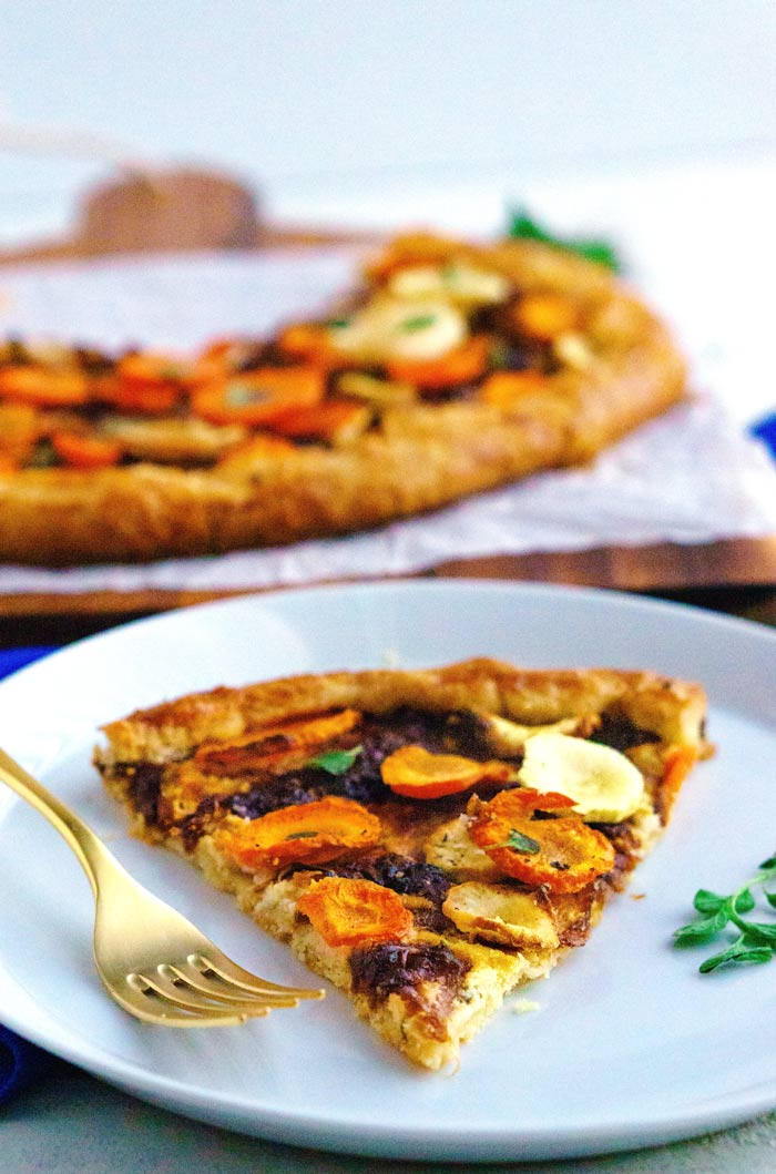 A slice of carrot galette on a white plate.
