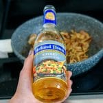 Pour in the cooking wine and cook until caramelized.