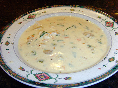 A bowl of soup on a plate