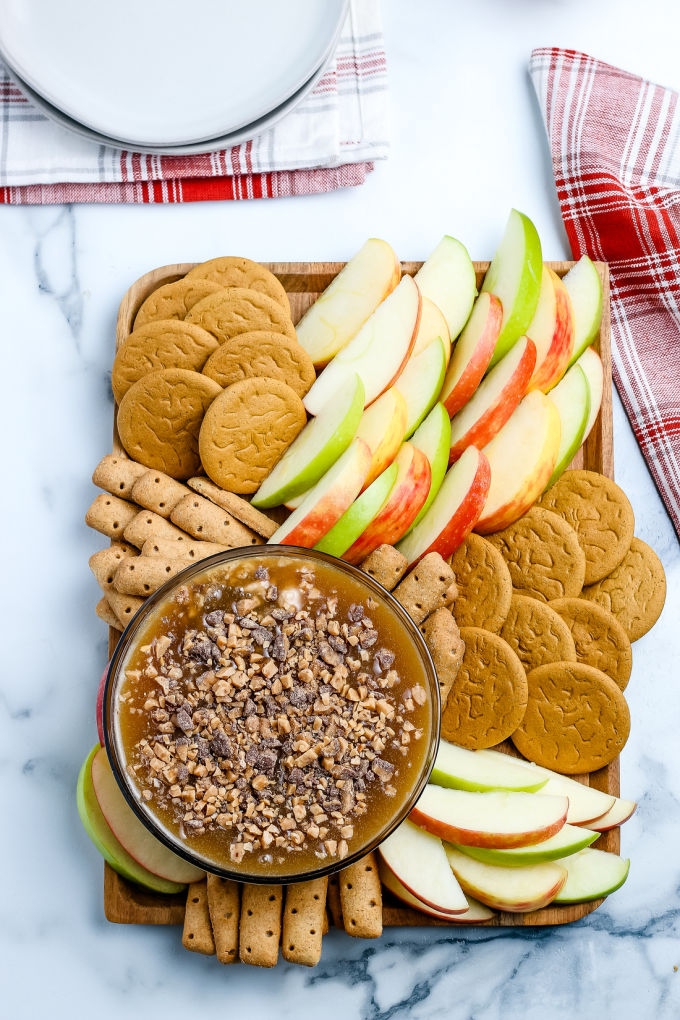This Cream Cheese Caramel Apple Dip consists of an easy homemade caramel sauce, cream cheese, brown sugar, and cinnamon.  via @foodfolksandfun