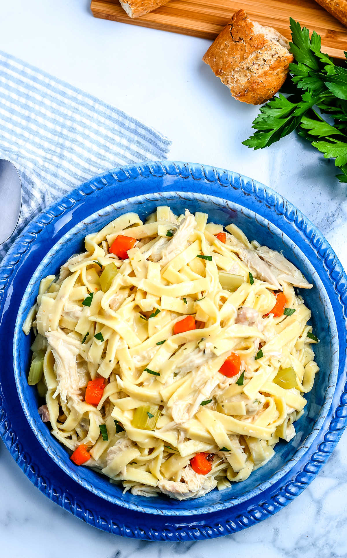 This Old Fashioned Chicken and Noodles recipe is a comfort food classic. It's chock-full of egg noodles, tender chicken, veggies, and a creamy sauce.  via @foodfolksandfun
