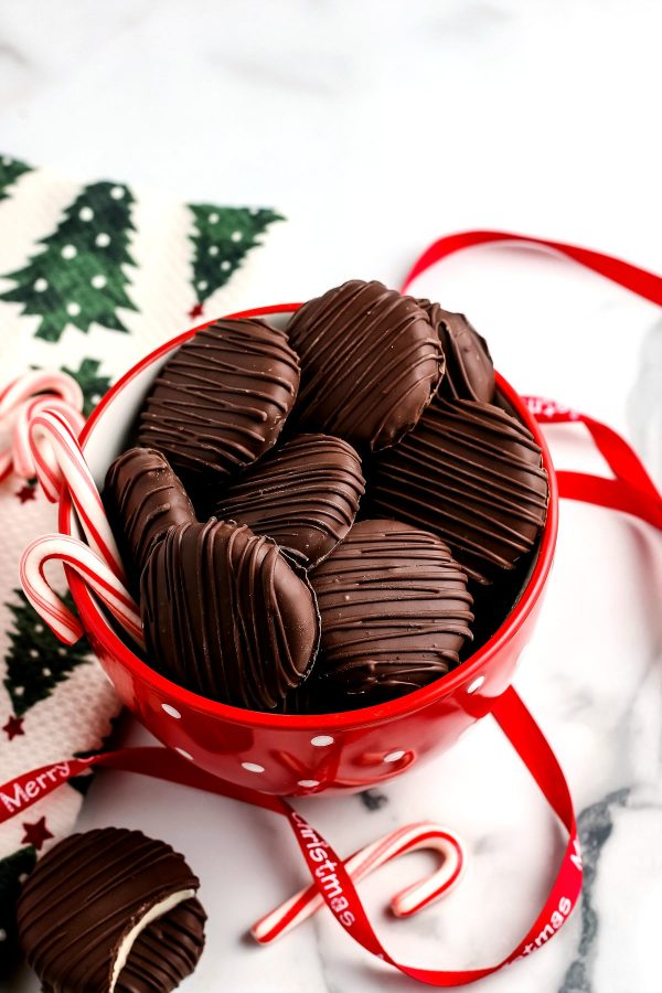 A red bowl that is filled with this finished peppermint patty recipe.