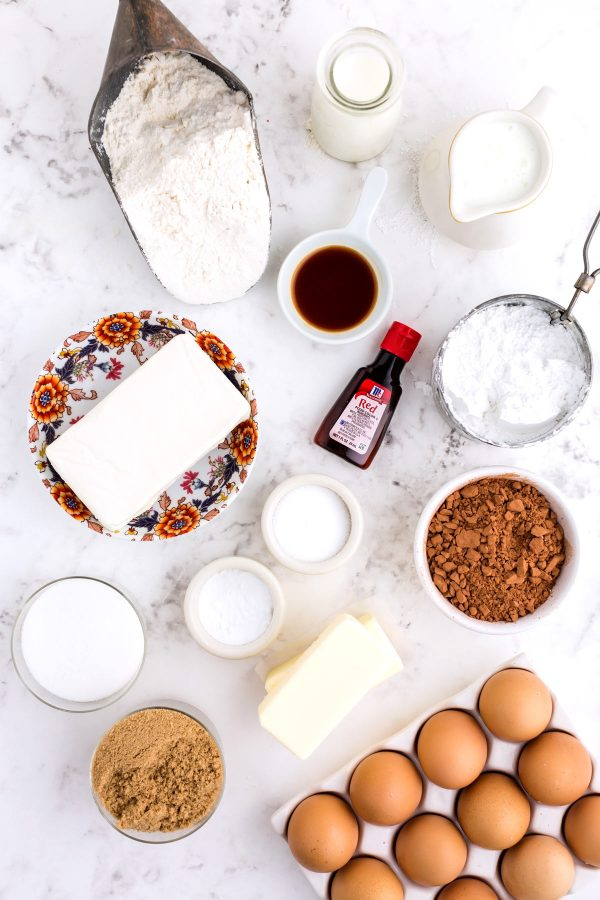 An overhead picture of all of the ingredients needed to make this red velvet whoopie pie recipe.