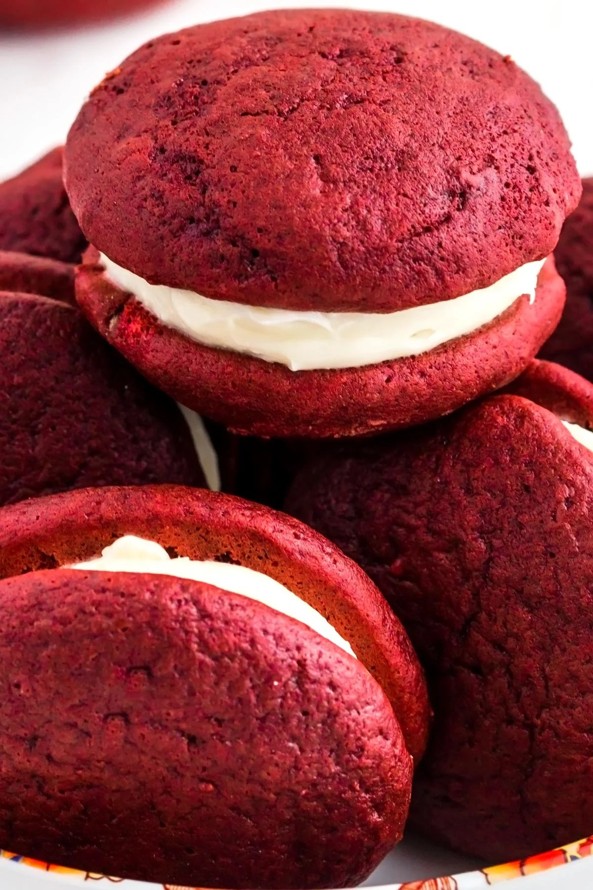 A close up picture of whoopie pies stacked on top of each other.