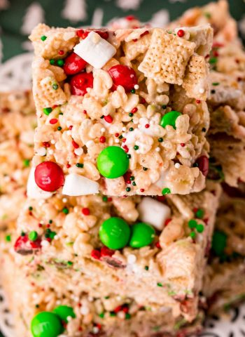A close up picture of Christmas Rice Krispie Treats stack on top of each other.