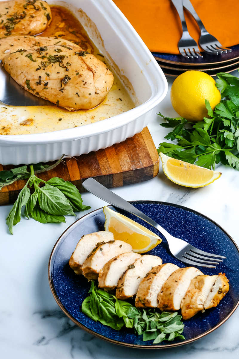 The finished Oven Baked Boneless Chicken Breast sliced on a blue plate.