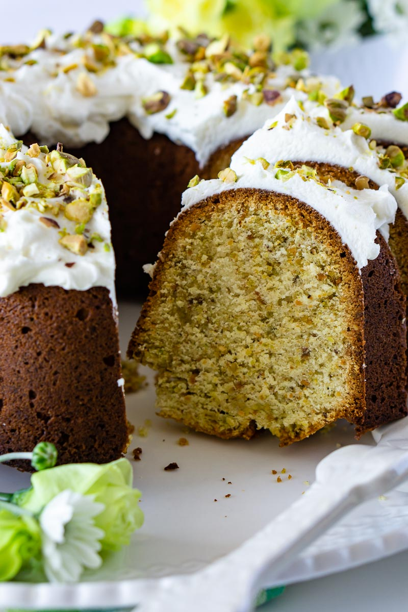 The finished Pistachio Bundt Cake recipe with slices taken out of the cake.