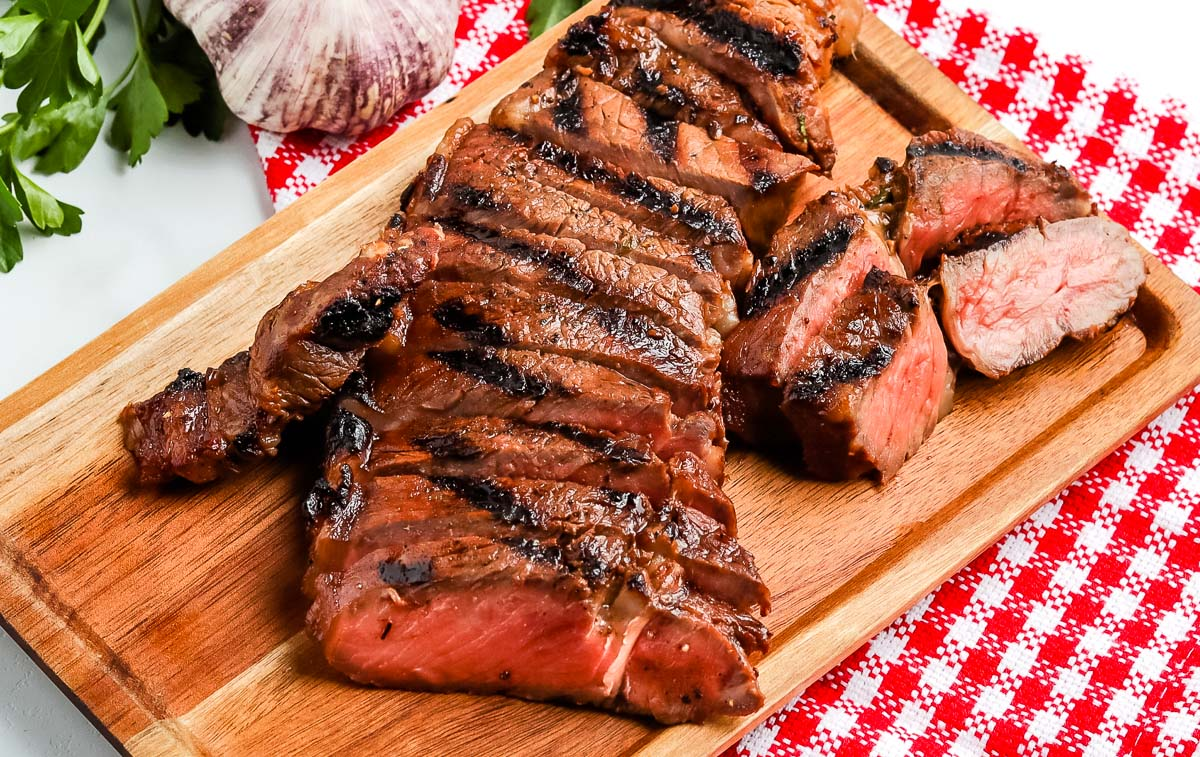 A finished grilled steak that was marinated.