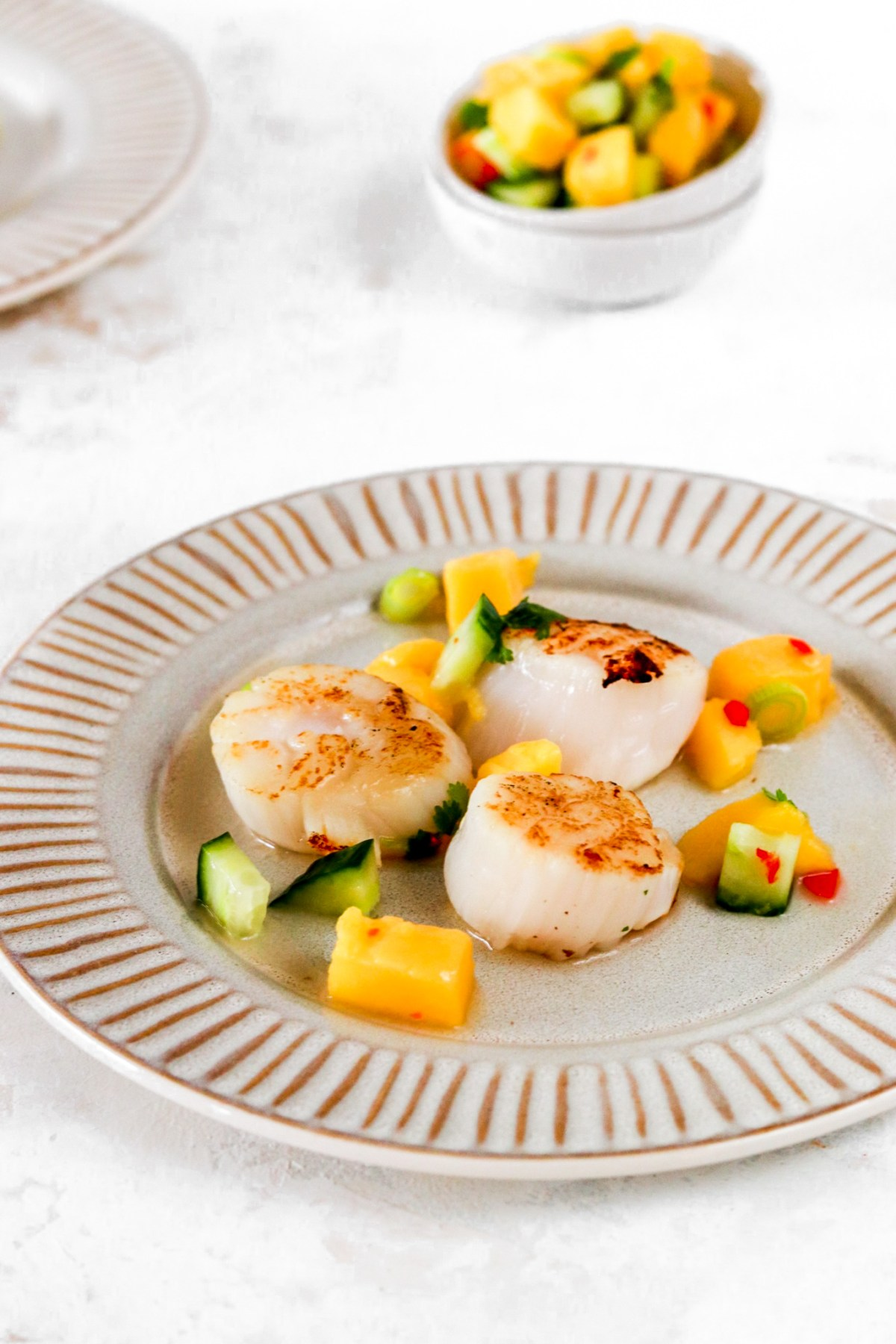 Scallops with Spicy Mango Salsa Close Up on Plate
