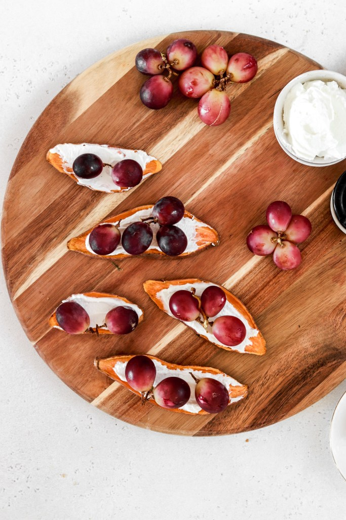 Sweet Potato Toast with Ricotta & Baked Grapes (Gluten & Grain Free)On A Cutting Board from Above