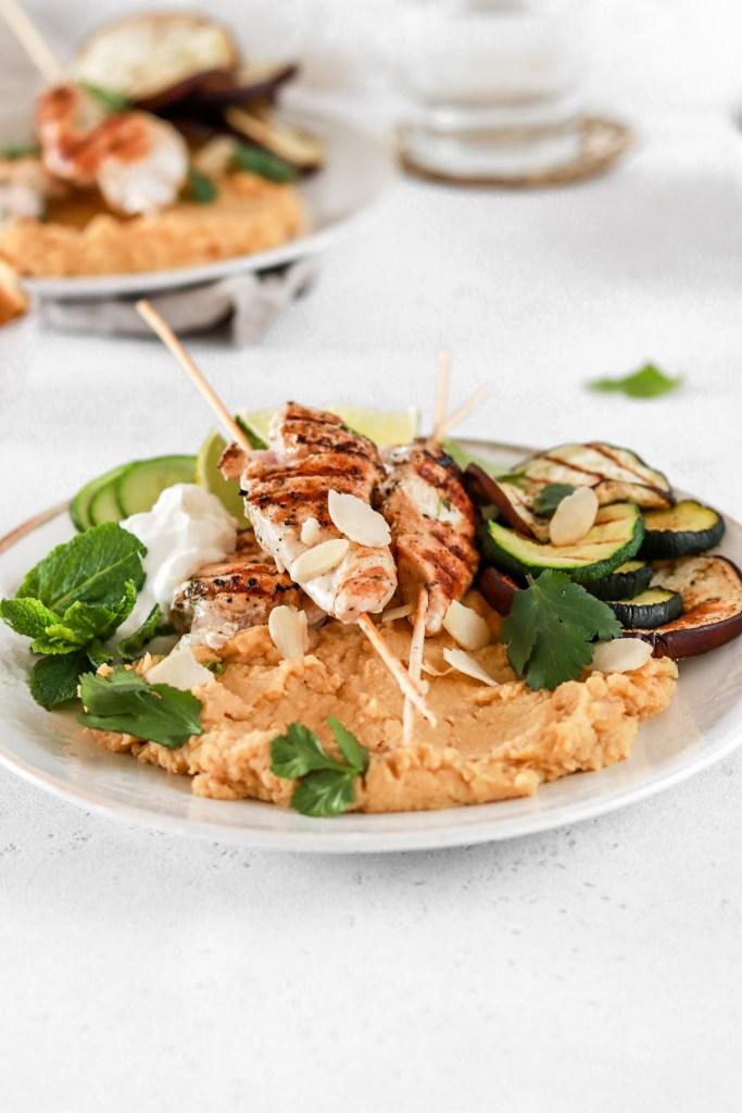 Lemon & Yogurt Marinated Chicken Skewers with Hummus (Gluten Free) On a Plate