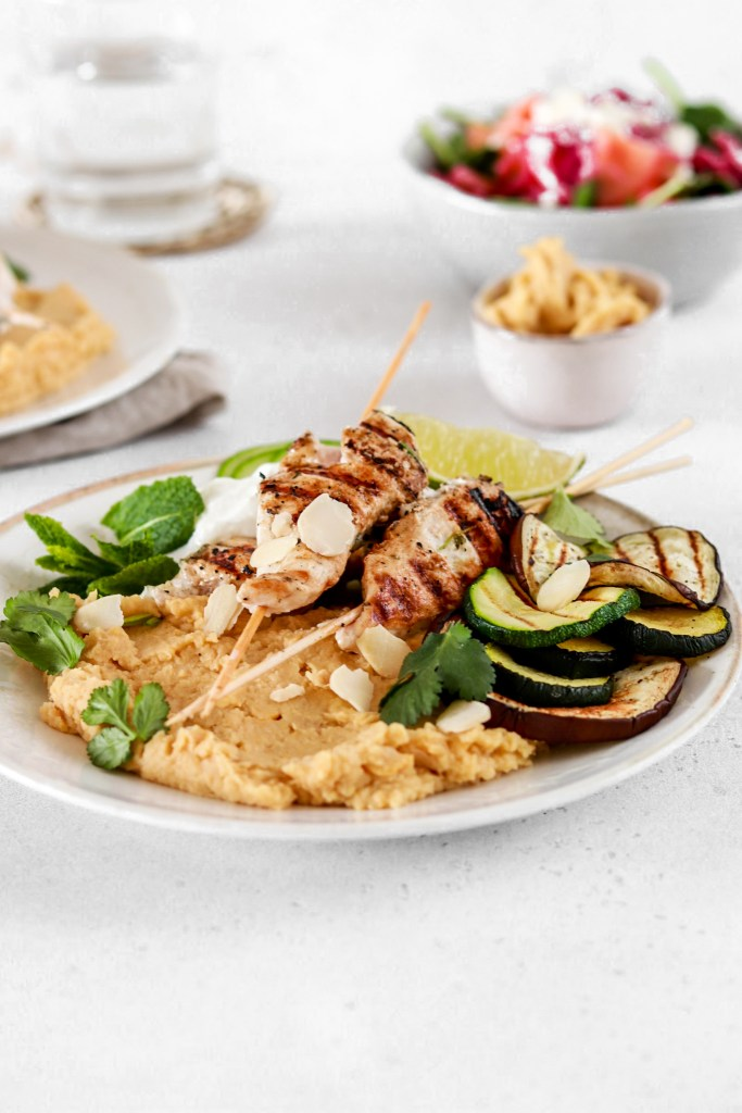Lemon & Yogurt Marinated Chicken Skewers with Hummus (Gluten Free) On A Plate Close up