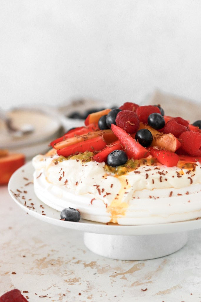 Pavlova with Summer Fruits & Berries (Sugar Free & Low Carb) From Front On Cake Plate Close Up